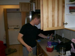 Jeremy unpacking the kitchen